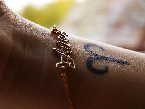 Small Aries Symbol Tattoo