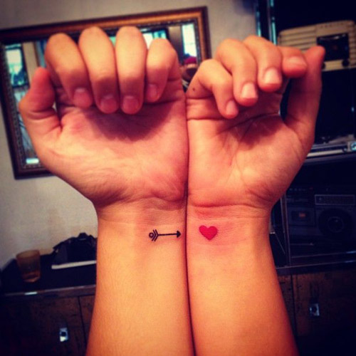 Cute arrow and heart couple tattoos on wrist