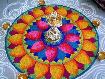 Diya In The Centre Of The Rangoli
