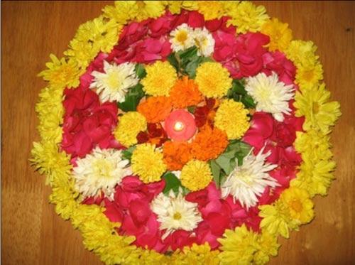 Rangoli With Flowers For Religious Celebration