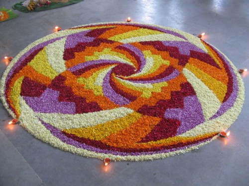 Different Petals Of Flowers And Diyas Rangoli Images