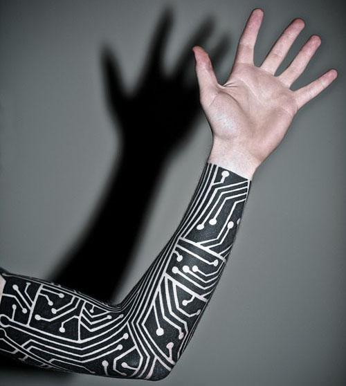 Electronic black ink sleeve tattoo