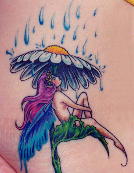 Fairy Sitting under the Rain Fairy Tattoo