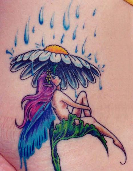 Fairy Sitting under the Rain Fairy Tattoo
