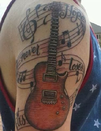 15 best guitar tattoo designs with meanings for girls guys. Black Bedroom Furniture Sets. Home Design Ideas