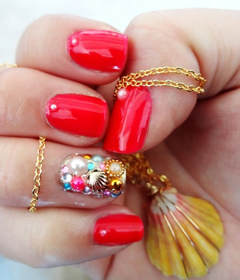 Red Nail designs with Jewellers