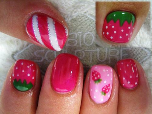 This nail design is decoratively done with a strawberry theme that's unique  to each finger nail. It is a pretty picture of art in its blissful form. - 9 Cute Strawberry Nail Art Designs Styles At Life