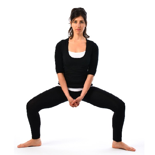 The Squat and Rise Yoga Pose