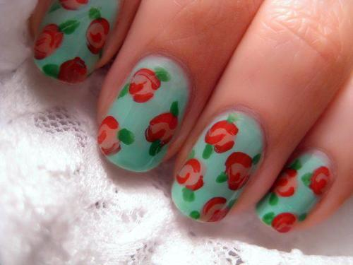 9 simple and easy rose nail art designs with images styles at life the vintage rose nail art design looks very simple yet spectacular the image of red roses with small green leaves on top of the light blue painted nails prinsesfo Gallery