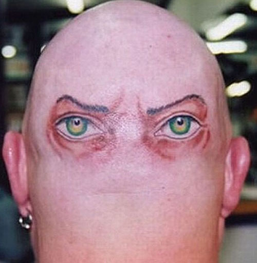 Eyes at the back of the head tattoo