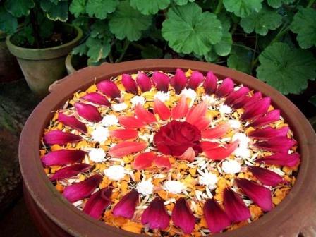 Circular Shaped Flower Rangoli In Water