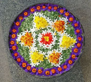 Colourful flower rangoli in water