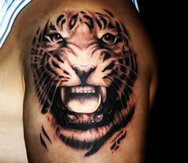 26 best animal tattoo designs and meanings styles at life for Best tiger tattoos