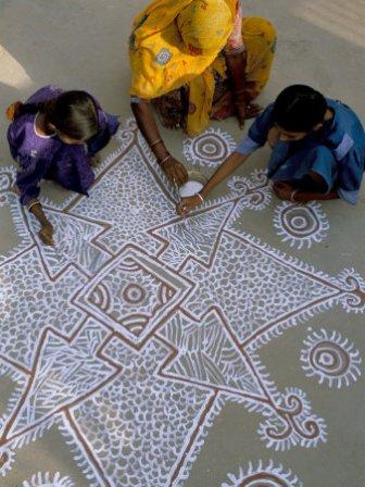 Beautiful Kolam Design using White and Brown
