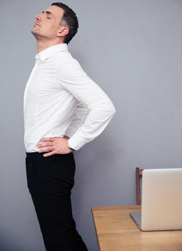 Businessman having backache in office