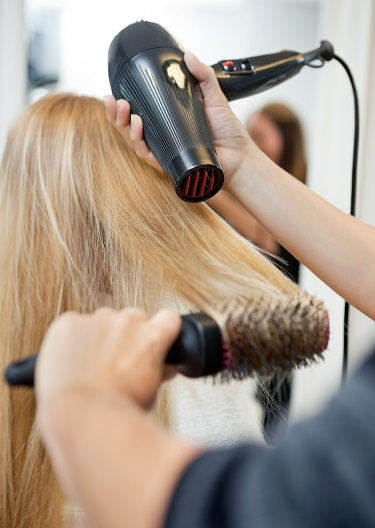 Simple and Easy Home Remedies for Hair Fall - Blow dry hair