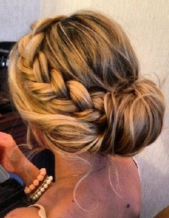 The heavy braided bun updo hairstyle