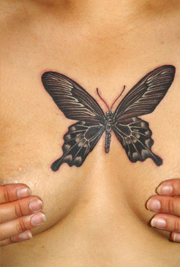 butterfly tattoo for the breasts