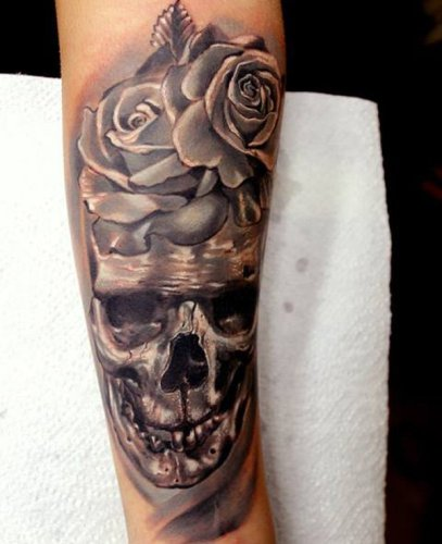 Skull and roses forearm tattoo