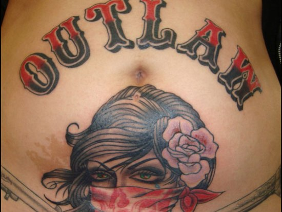 Outlaw stomach tattoo