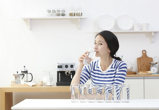 Asian woman drinking water