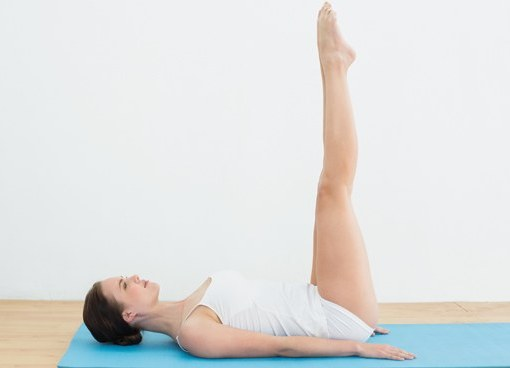 Raised foot pose yoga