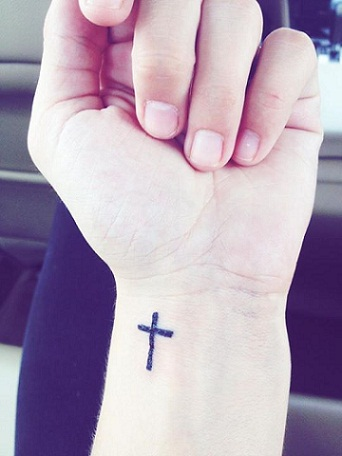 small cross tattoo on wrist