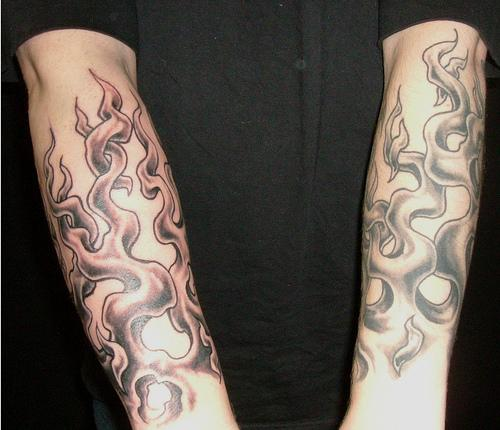 The Burning Flame Tattoos on Arm