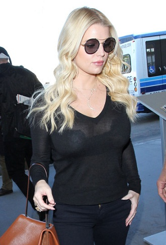 Jessica Simpson wears a see through top at LAX **USA ONLY**