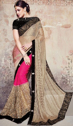 10. Stone worked beige coloured net bridal saree