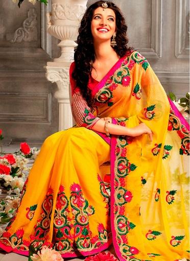 14.Yellow coloured faux chiffon wedding saree with stone works