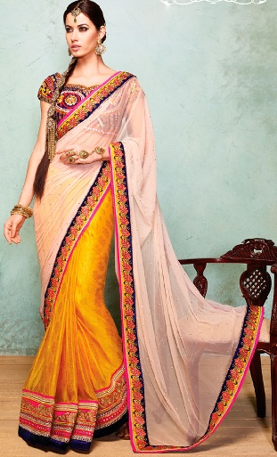 15. Yellow silk and net saree with heavy embroidery stone work