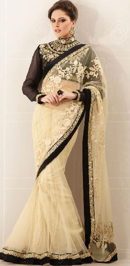 5. Cream designer net saree embroidery stone work