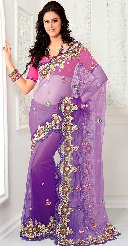 6. Unique violet net saree with stone work