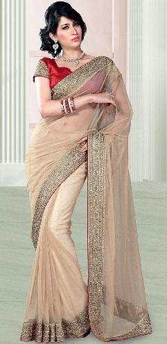9. Cream coloured net saree with mono coloured border