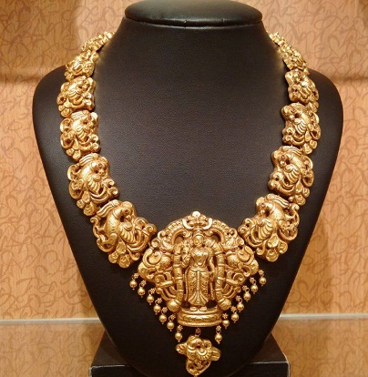 gold-temple-jewellery-designs-motif-necklace-with-goddess