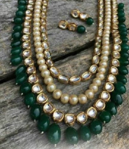 4f0ae94bc This green pearl necklace is one which can be adorned by women on simple  attires to give a heavy look. It is not minimal jewellery and hence has to  worn on ...
