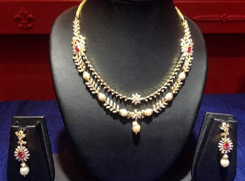 layered-diamond-necklaces-with-south-sea-pearls