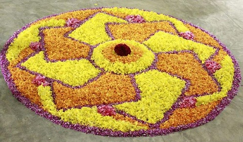 swastik-rangoli-free-hand-design-with-flowers13
