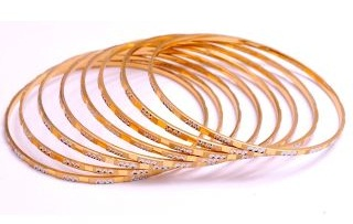 A set of Thin Gold Rolled Bangles