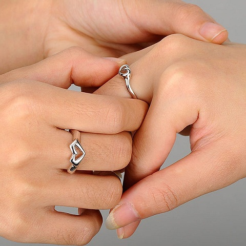 Couples hand and heart rings