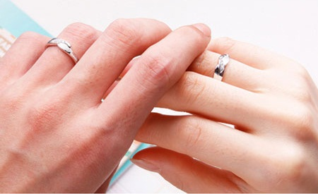 Love engraved couples engagement rings