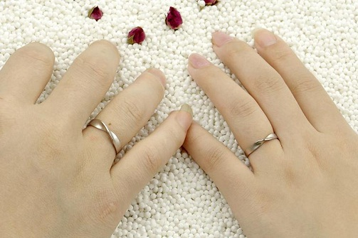 Twisted designer couples engagement rings
