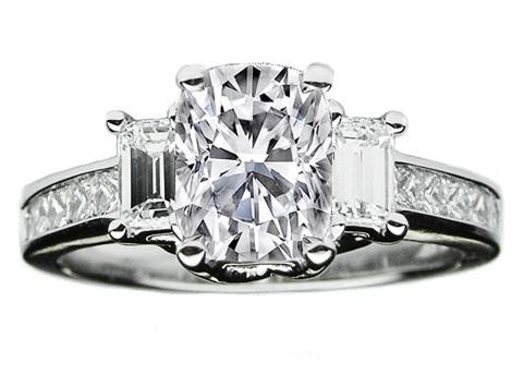 three stoned cushion cut engagement ring