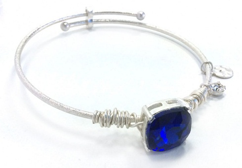 Blue sapphire square gemstone on a silver wire bracelet