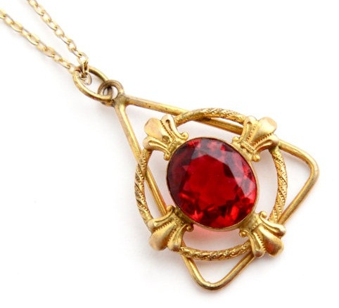 9 beautiful ruby pendant designs for womens in trend styles at life triangular single ruby stud gold pendant aloadofball Images
