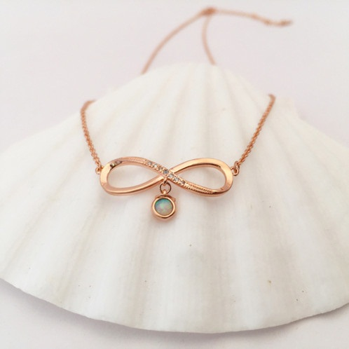 Rose gold-white opal ribbon pendant