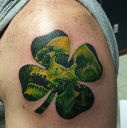 Clover tattoo with skull design