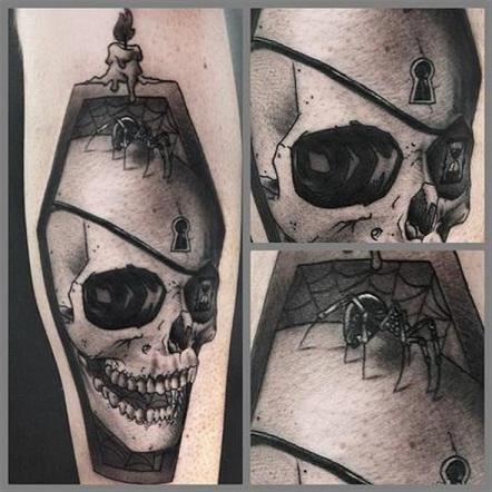 Comic coffin tattoo