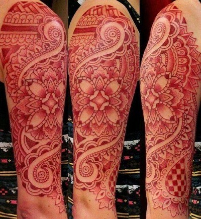 Complex red tattoo design